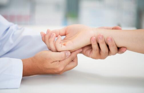 Orthopedic doctor examines patient hand